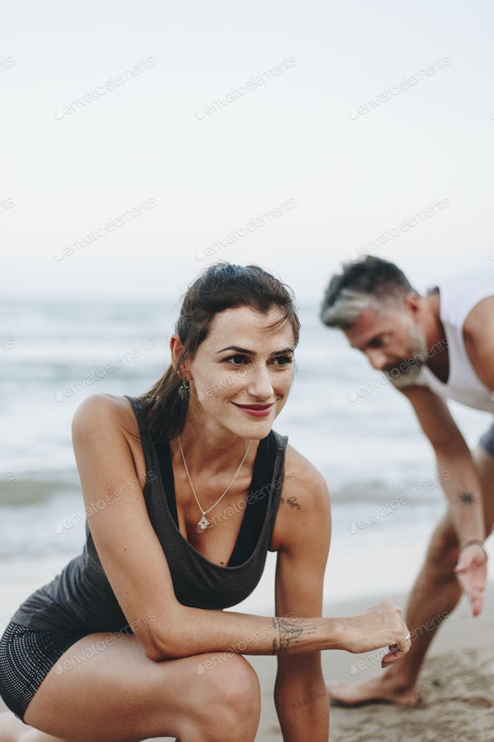 Couple stretching at the beach