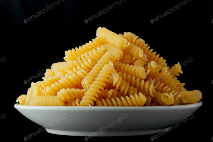 Bowl with raw pasta