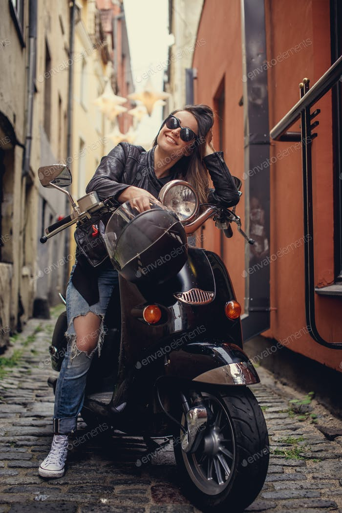 Casual female on moto scooter
