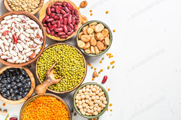 Legumes, lentils, chikpea and beans assortment on white