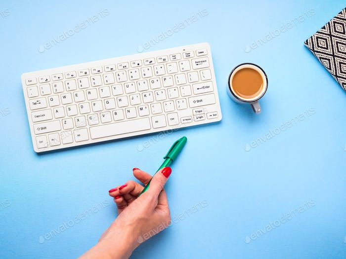 Keyboard, coffee and pen. Writing concept
