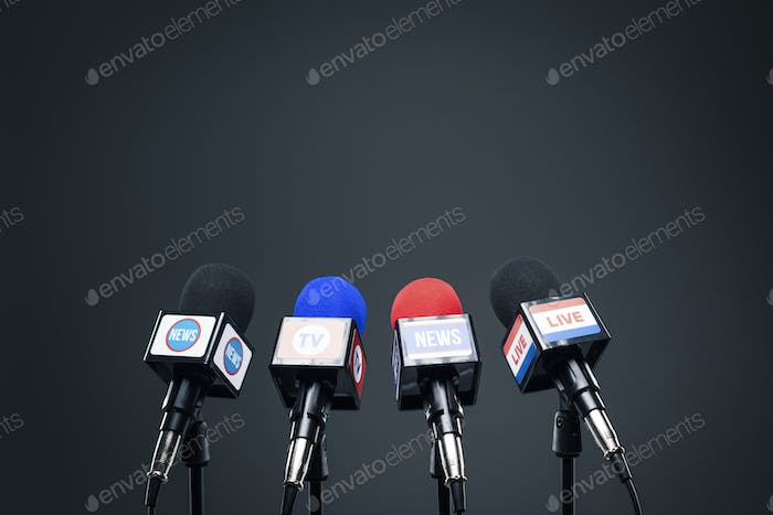 Set of microphones ready for the press conference