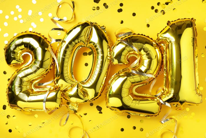Golden foil balloons made numbers 2021 on yellow background with light bokehs. Happy new year
