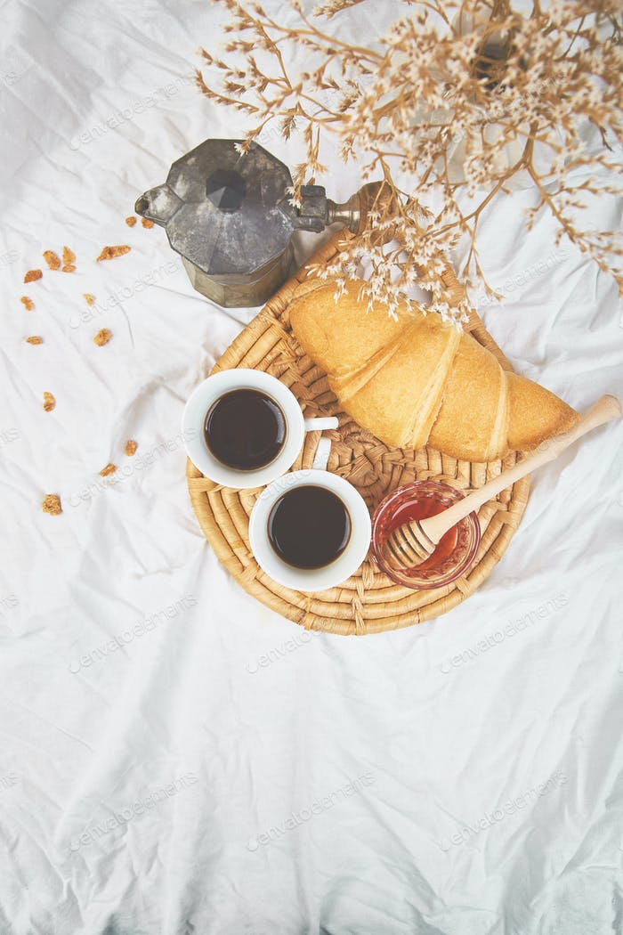 Good morning. Two cup of coffee with croissant and jam.