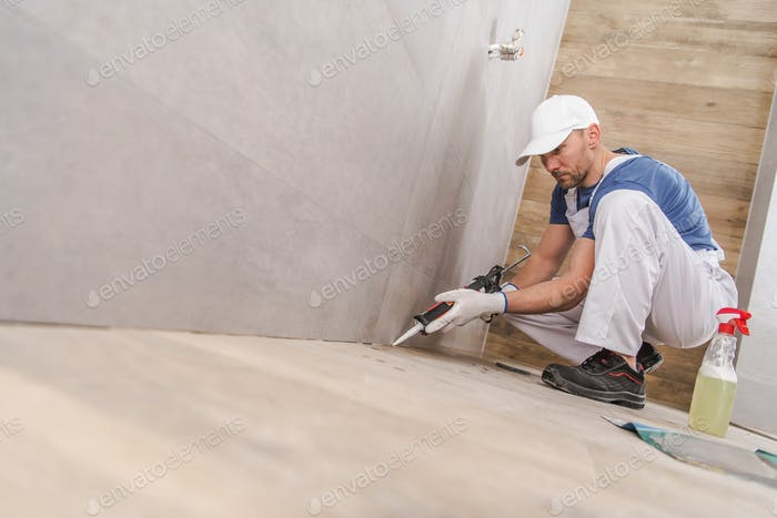 Worker Sealing Ceramic Tiles