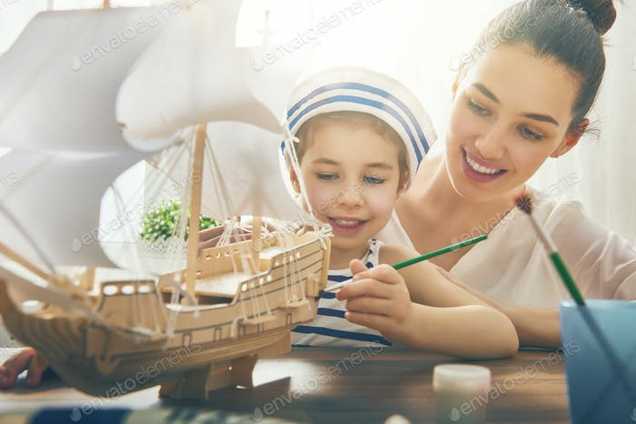 girl making model ship