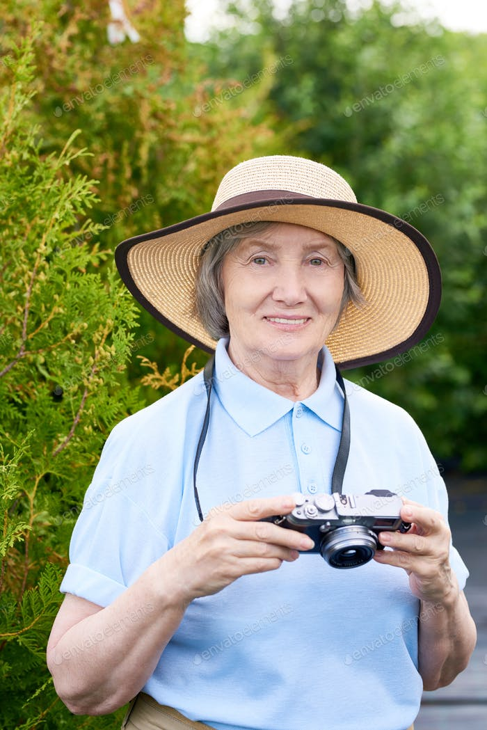 Senior Woman Taking Pictures on Vacation