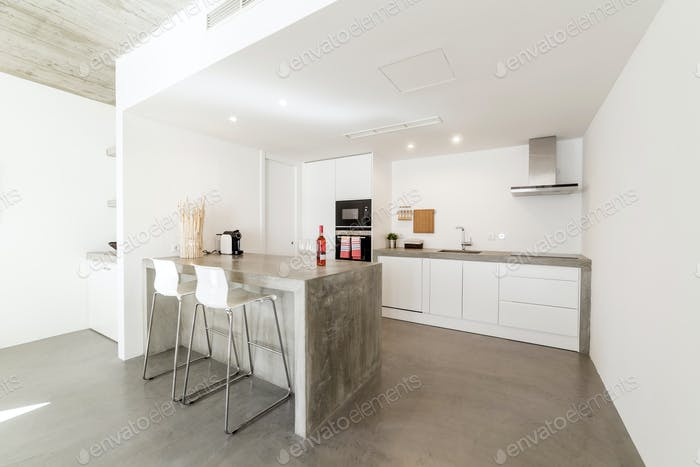 modern kitchen with gray tile floor and white wall