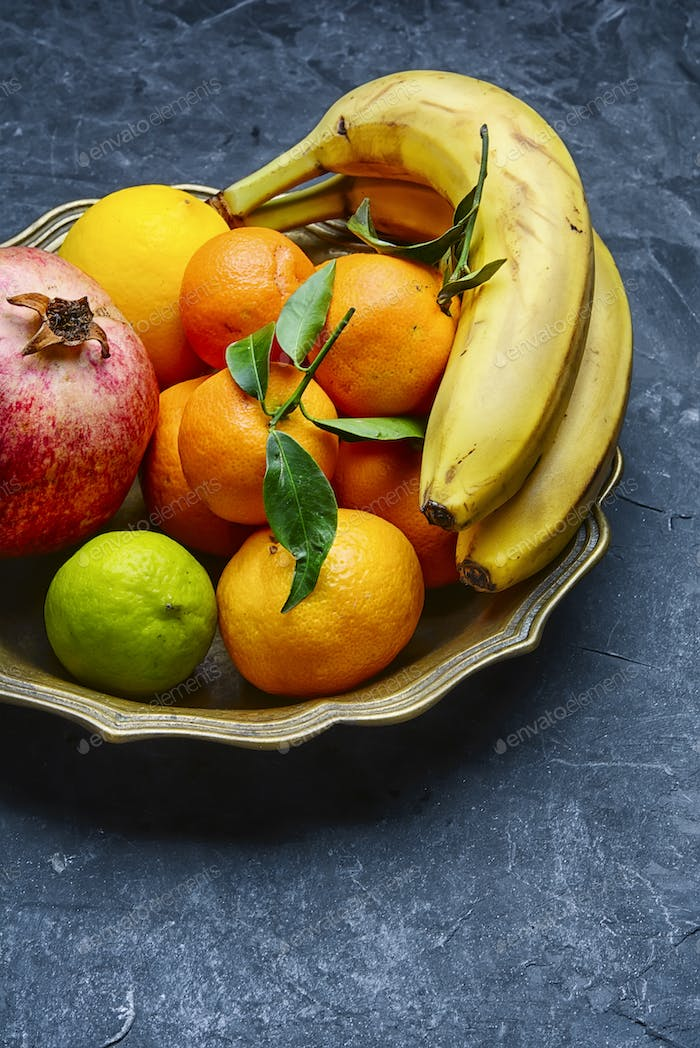 Dish with tropical fruits and citrus