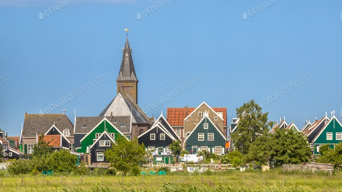 Traditional dutch Village with with colorful houses and church