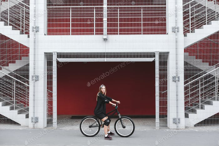 Girl with street bicycle