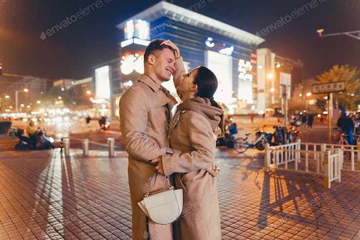 young couple showing affection in the middle of Beijing China