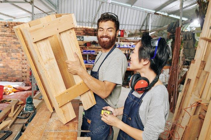 Happy team of carpenters