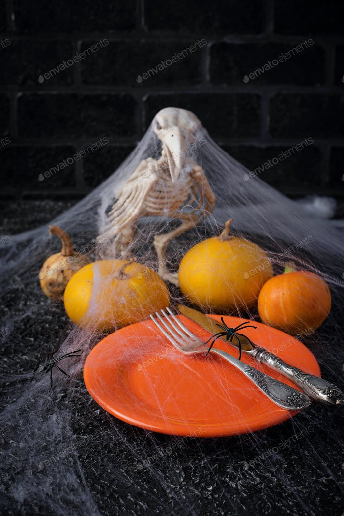 Halloween table setting with plate and web