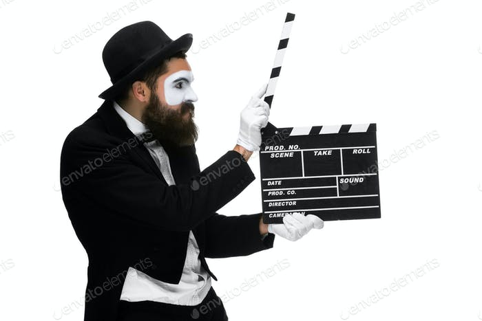 Mann im Bild Pantomime mit Movieboard