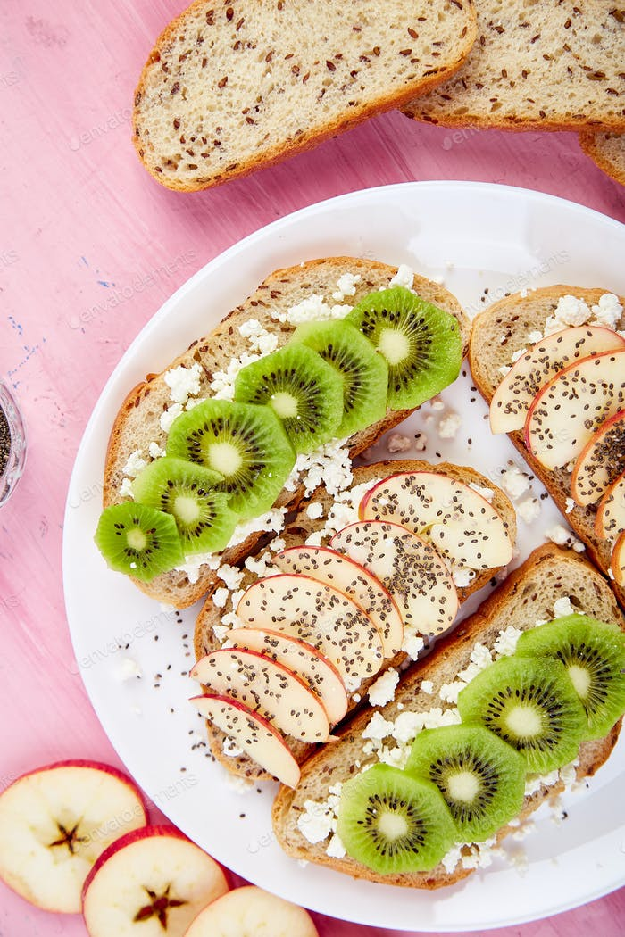 Healthy breakfast toasts with kiwi, apple, cottage cheese and chia seeds