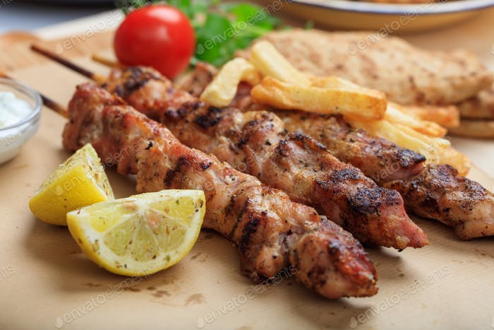Grilled meat skewers on a table