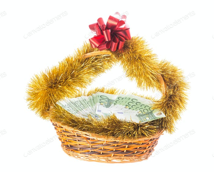 Wicker basket full of euro bills.
