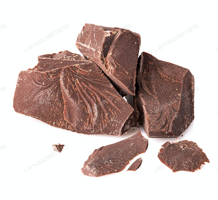 Chocolate pieces close-up isolated on a white background.