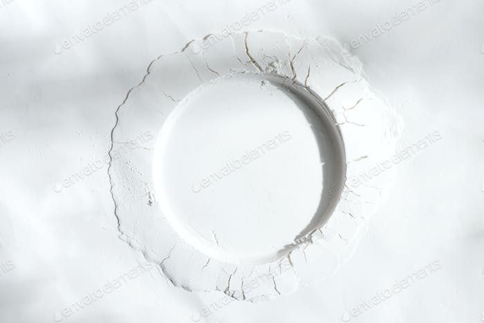 Round frame from white powder or flour with shadow