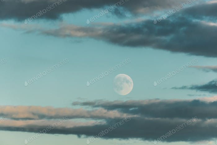 Full Moon At Blue Evening Cloudscape Sky Background