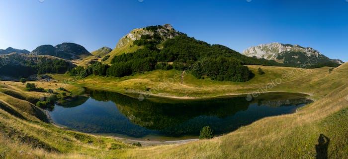 Panoramic photo of mountain lake