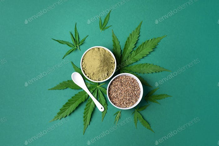 Different types of hemp extract products - cannabis leaves, seeds, protein powder, flour on green