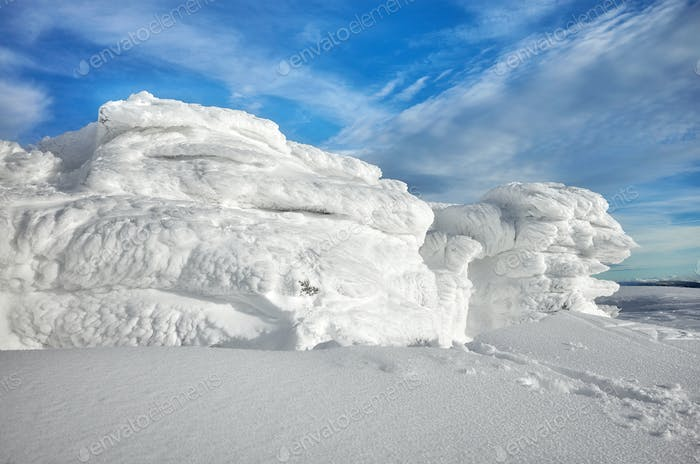 Natural ice formations created by snow and wind.