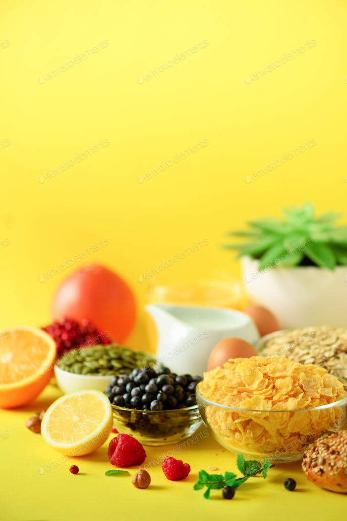 Corn cereal, muesli, milk, berries, orange juice, yogurt, boiled egg, nuts, fruits, banana, peach
