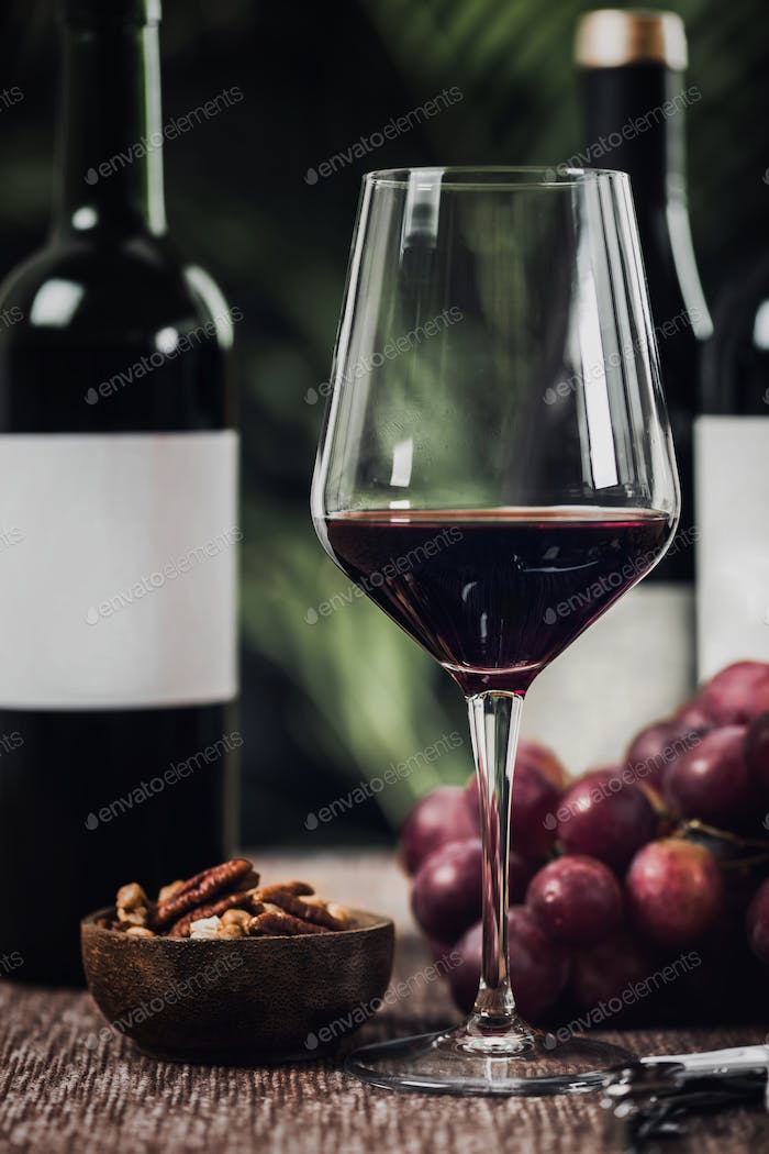 Bottles Of Red Wine, Wine Glasses And Grapes