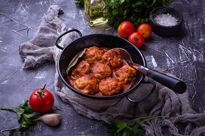 Meatballs with tomato sauce.