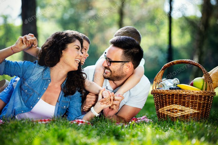 Family picnic outdoors togetherness relaxation happiness concept