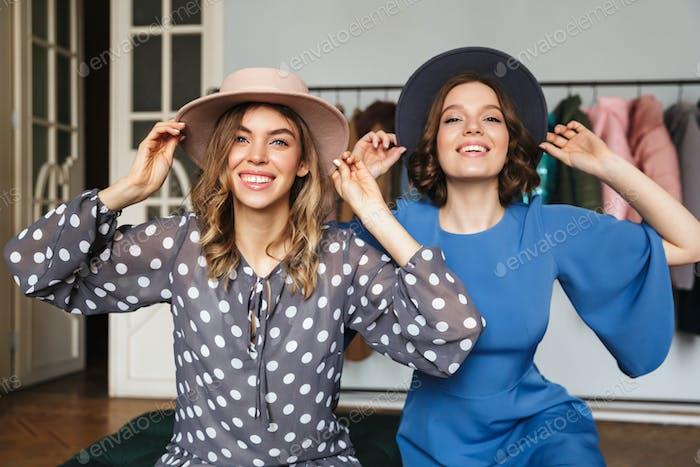 Smiling amazing young women wearing hats.