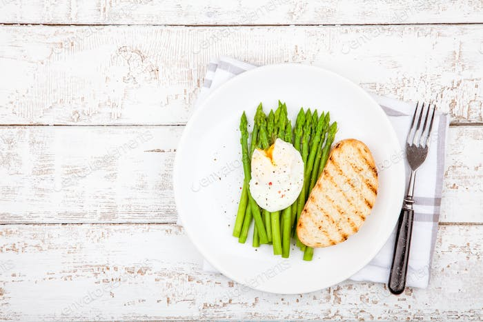 Breakfast: poached egg with asparagus and toasted ciabatta