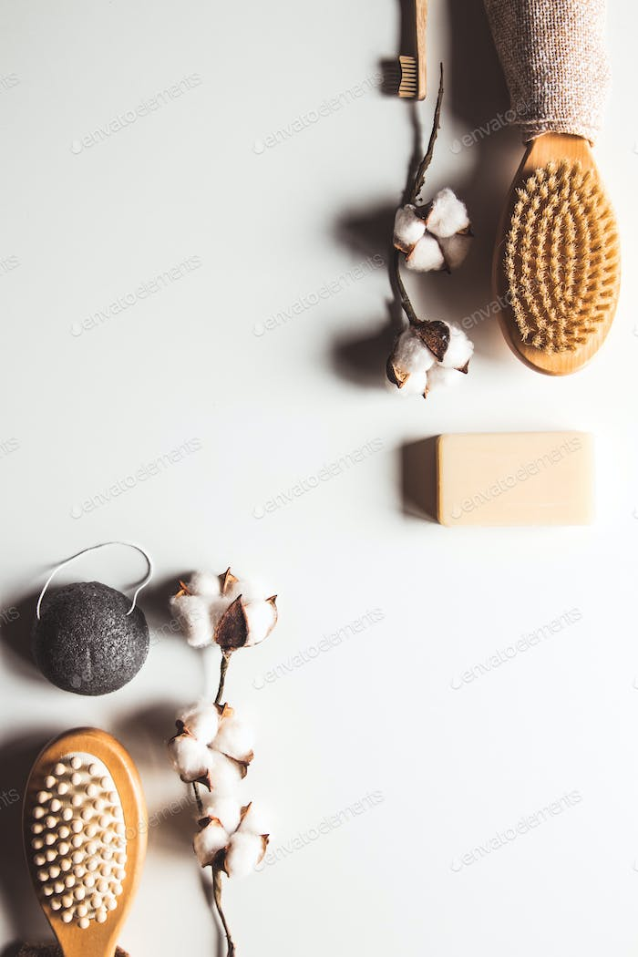 Natural brushes made of wood and soap on the background of concrete, bamboo toothbrushes PNOV2019