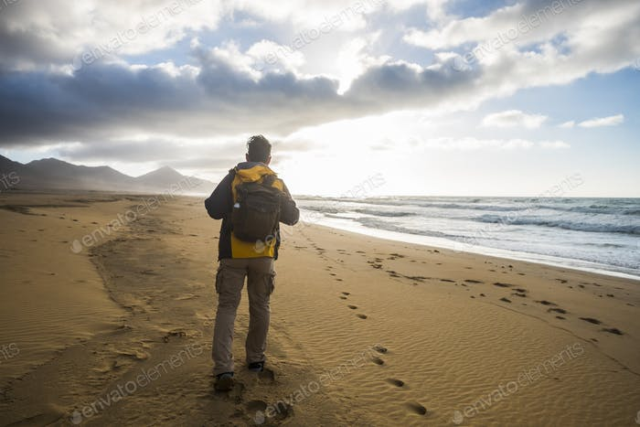 Lonely man explore beach with nobody