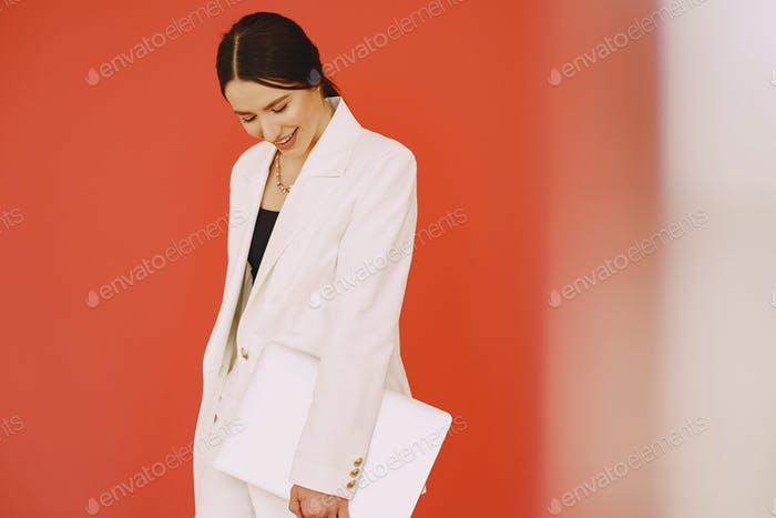 Woman standing on a red background
