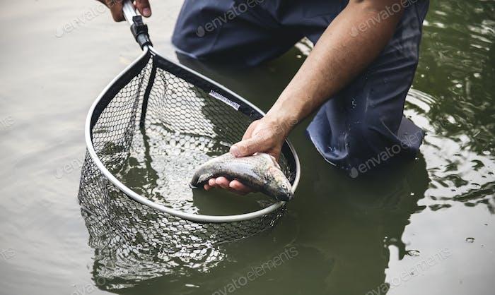 Man fishing by the lake