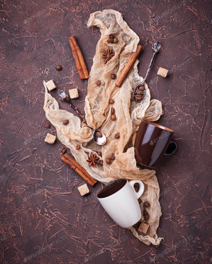 Creative coffee background with beans, sugar and cinnamon. Flatlay style