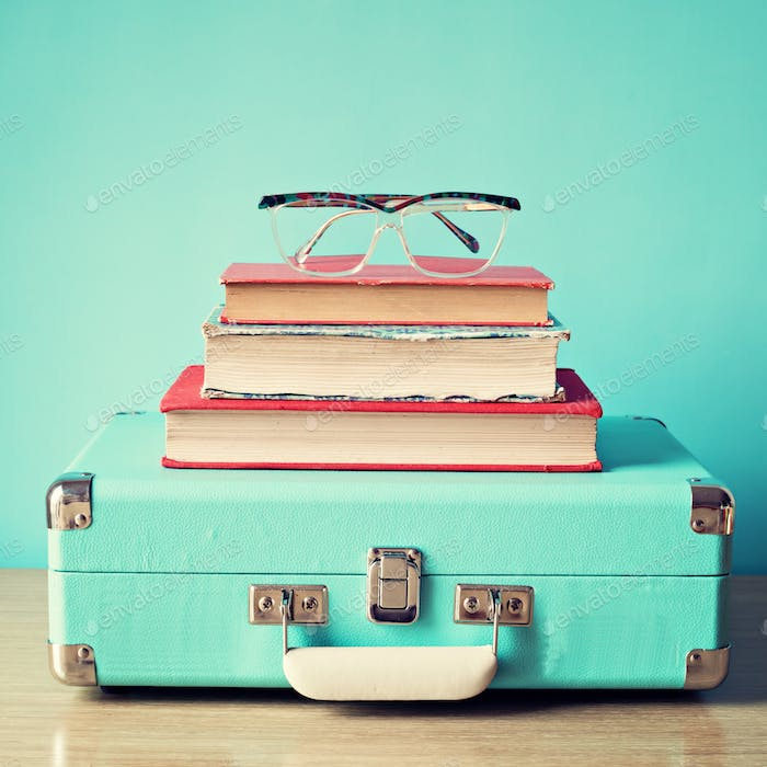 Hipster and retro books, suitcase and galsses