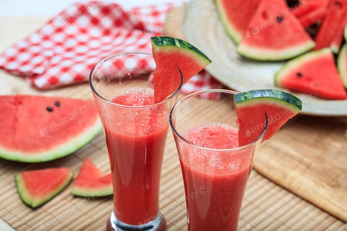 Watermelon juices preparation on a wooden table