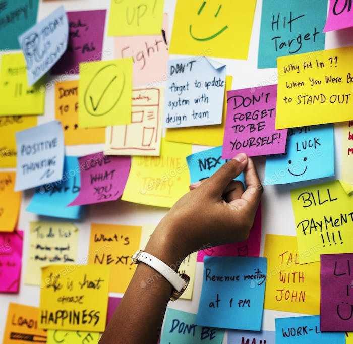 Sticky notes on an office wall