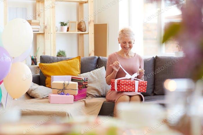 Lady opening gift box