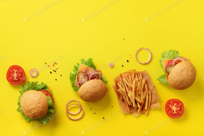 Fast food banner. Juicy meat burgers with beef, tomato, cheese, onion, cucumber and lettuce on