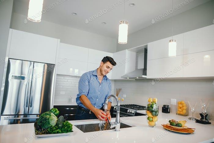 handsome man in a kitchen