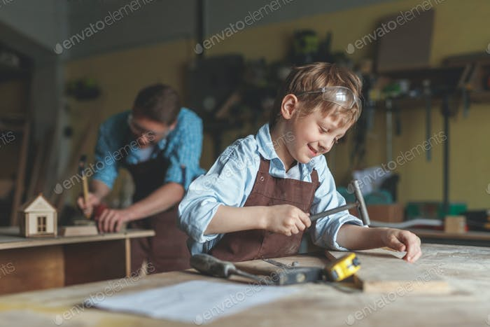 Little boy in the carpentry