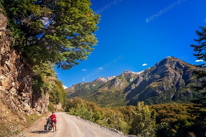 Woman cycling in argentinian Lake District