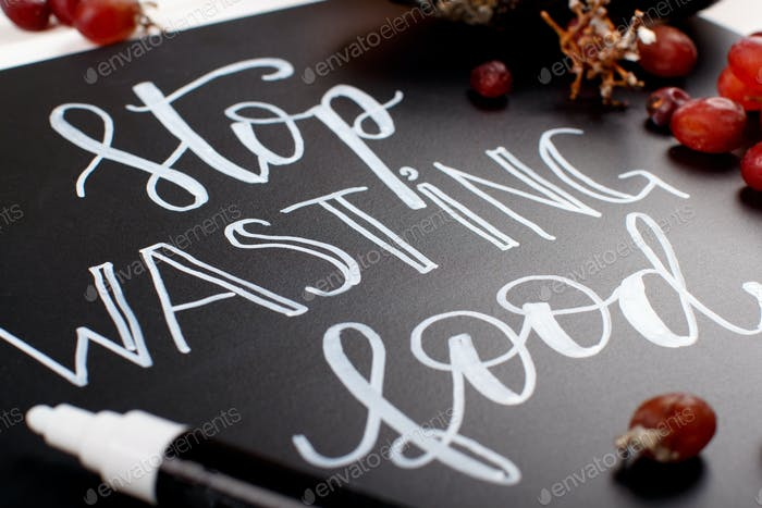 Chalkboard with Stop wasting food lettering