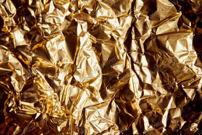 crumpled golden foil with shadows and twinkles