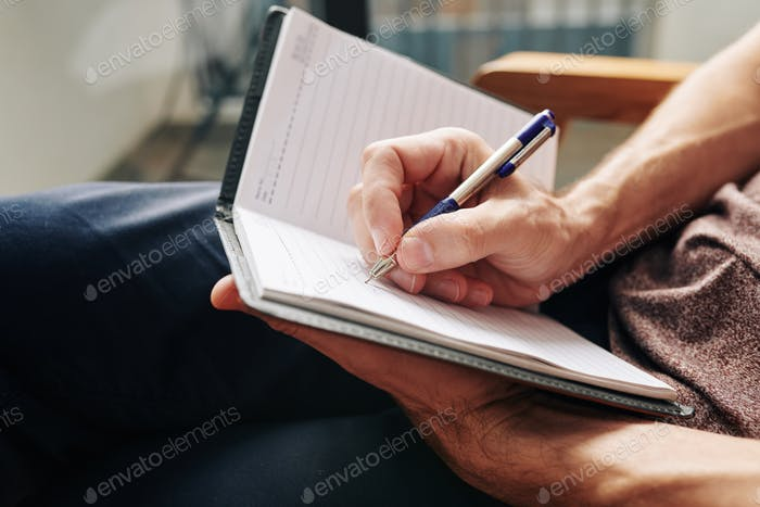 Man writing down thoughts